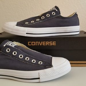 NEW with box unisex slip on Converse shoes.